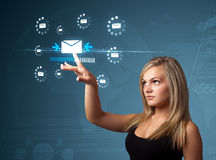 Businesswoman pressing virtual messaging type of icons stock images