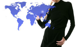 Businesswoman pressing world map touchscreen Royalty Free Stock Image