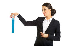 Businesswoman pretending to drop a binder Stock Photography