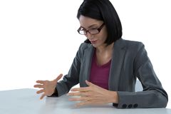Businesswoman pretending to hold invisible object Royalty Free Stock Photography