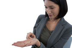 Businesswoman pretending to hold invisible object Royalty Free Stock Photo