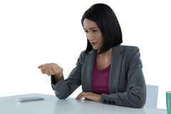 Businesswoman pretending to hold invisible object Stock Photography