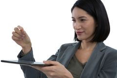 Businesswoman pretending to hold invisible object while using digital tablet. Close-up of businesswoman pretending to hold invisible object while using digital Stock Image