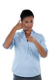 Businesswoman pretending to talk on a cell phone. Portrait of businesswoman pretending to talk on a cell phone Royalty Free Stock Photography