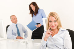 Businesswoman pretty smile sit in office colleague Stock Photos