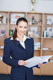 Businesswoman with product catalog Royalty Free Stock Images