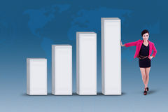 Businesswoman and profit bar chart on blue Stock Photography