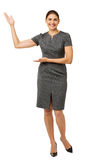 Businesswoman Promoting An Imaginary Product Royalty Free Stock Photo