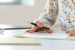 Businesswoman proofreading a contract stock photography