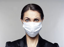 Businesswoman with protect mask on her face Stock Photography