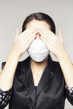 Businesswoman with protect mask on her face Stock Photos