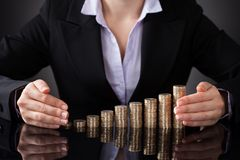 Businesswoman protecting the coins Stock Images