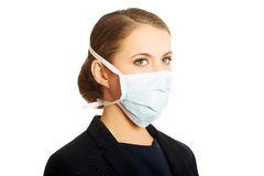 Businesswoman with protecting mask Royalty Free Stock Photos