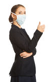 Businesswoman with protecting mask Stock Photo