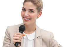 Businesswoman public speaking. With microphone stock photo