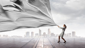 Businesswoman pull fabric banner Stock Photography