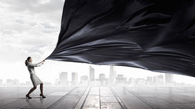 Businesswoman pull fabric banner Royalty Free Stock Photography