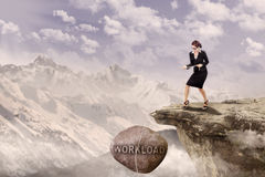 Businesswoman pull Loan rock outdoor Stock Photography