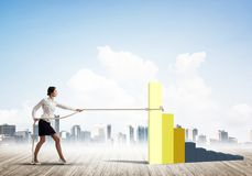 Businesswoman pulling arrow with rope and making it raise up Royalty Free Stock Images