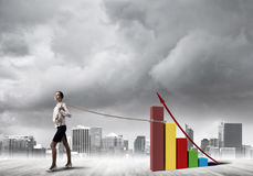 Businesswoman pulling arrow with rope and making it raise up Royalty Free Stock Photos