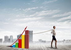 Businesswoman pulling arrow with rope and making it raise up Stock Image