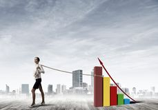 Businesswoman pulling arrow with rope and making it raise up Royalty Free Stock Photography