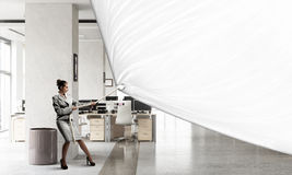 Businesswoman pulling banner Stock Photos