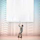 Businesswoman pulling blank banner Royalty Free Stock Image