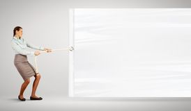 Businesswoman pulling blank banner Stock Images