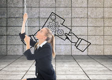 Businesswoman pulling a chain Stock Images