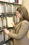 Businesswoman Pulling File Folder Stock Image