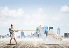 Businesswoman pulling graph with rope as concept of power and control Stock Photography