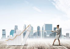 Businesswoman pulling graph with rope as concept of power and control Stock Image