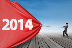 Businesswoman pulling new year 2014 Royalty Free Stock Images