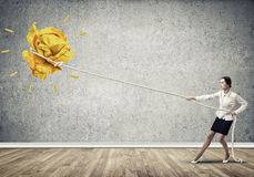 Businesswoman pulling paper ball with rope and making it raise up Royalty Free Stock Image