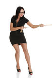 Businesswoman pulling on a rope Stock Photo