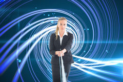 Businesswoman pulling a rope Stock Photos