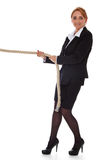 Businesswoman pulling rope Stock Photography