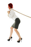 Businesswoman pulling a rope Royalty Free Stock Photo