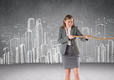 Businesswoman pulling rope in room. Digital composite of Businesswoman pulling rope in room Royalty Free Stock Image