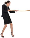 Businesswoman pulling a rope Royalty Free Stock Images