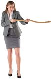 Businesswoman pulling a rope Royalty Free Stock Photography