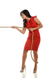 Businesswoman Pulling Rope Royalty Free Stock Image