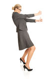 Businesswoman pulling a stick Royalty Free Stock Image