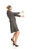 Businesswoman pulling a stick Stock Photos