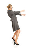 Businesswoman pulling a stick Stock Photography