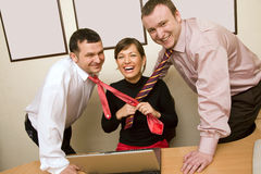 Businesswoman pulling ties Stock Photos