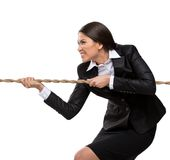 Businesswoman pulls the rope. Isolated on white. Concept of competition and job competitive promotion Royalty Free Stock Photos