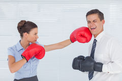 Businesswoman punching her colleague while boxing together Stock Photo