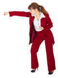Businesswoman punching isolated on white Royalty Free Stock Image